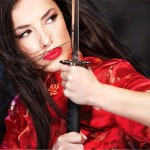 beautiful woman in Chinese clothes holding sword