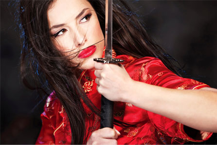 beautiful woman in Japanese clothes holding katana sword