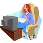 a woman eating in front of the TV