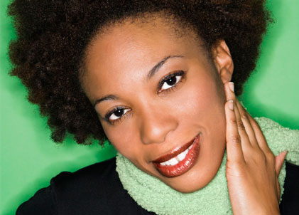 black woman beautiful brows green background