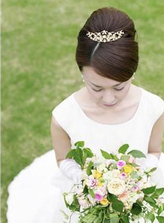 bride sitting on the grass