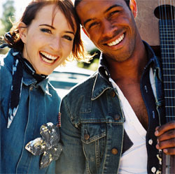 laughing couple with guitar